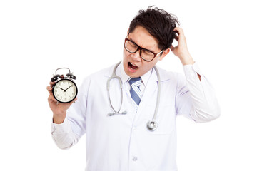 Asian male doctor yawn with a clock
