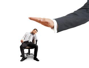 big hand ready to slap lazy businessman