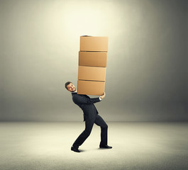 man carrying four boxes on the hands