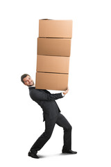 man carrying four heavy boxes