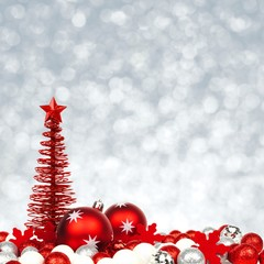 Christmas border of red and white ornaments on silver background