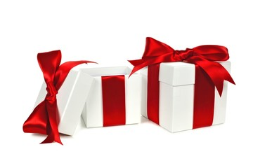 Two white Christmas gift boxes, one open, with red ribbon