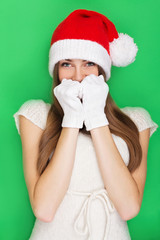 Pretty young girl with Christmas hat and gloves