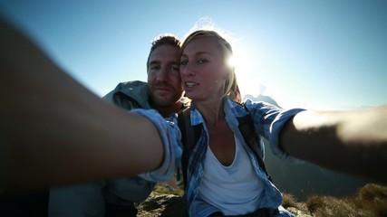 Couple taking selfie from mountain summit