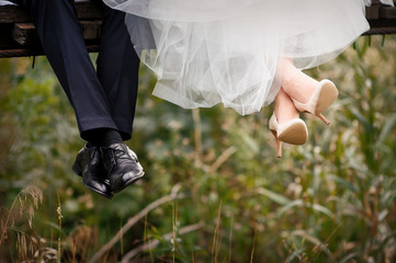 feet of bride and groom, wedding shoes