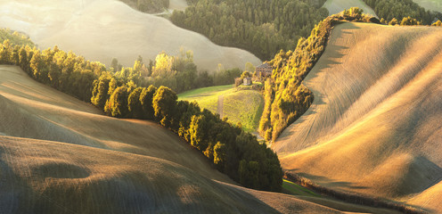 Tuscany in the beautiful landscapes of the setting sun.