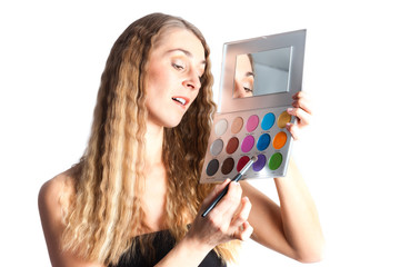 Woman putting make-up on