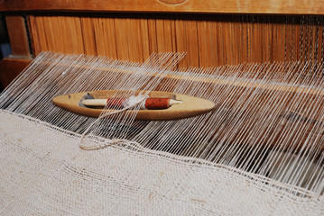 shuttle on the antique loom