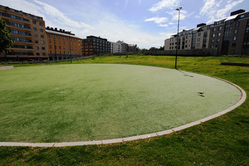 round green lawn in a residential area of Helsinki