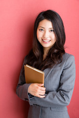 portrait of asian businesswoman on red background