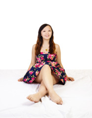 Young Chinese Woman Sitting Floral Dress Smiling