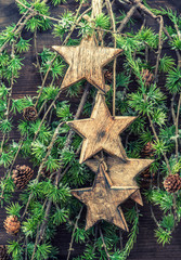 christmas decorations wooden stars and pine tree branches
