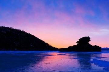Magic sunrise on winter lake Borovoe. Kazakhstan.