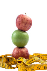 healthy diet concept ,apple and a measuring tape