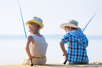 Boy and girl with fishing rods