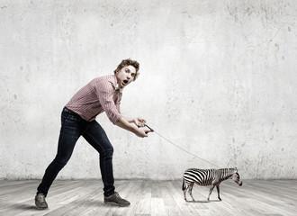 Man with zebra