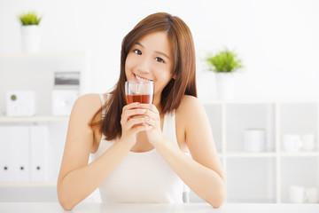 beautiful Young asian woman drinking hot tea