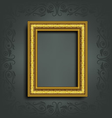 Golden frame with ornament and shadow on grey background with or