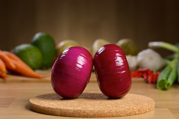Red onion bulb on the wooden background