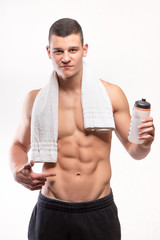 Muscular fitness man with bottle and towel