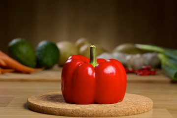 Red pepper on a wooden table