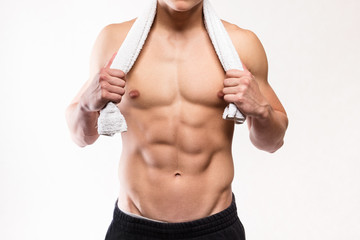 Fitness muscular man torso with towel