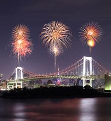 Fireworks celebrating over Tokyo Rainbow Bridge at Night