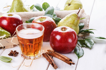 Fresh fruits and drink over white background