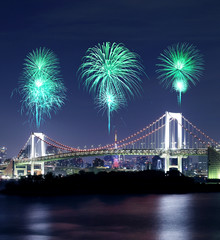 Fireworks celebrating over Tokyo Rainbow Bridge at Night