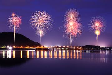 Fireworks celebrating over Lake Kawaguchiko at night with mount