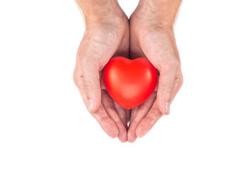 male hand holding a heart