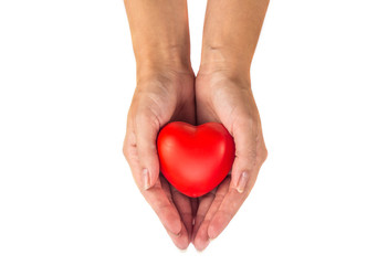 female hand holding a heart