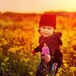 laughing small girl with field flowers