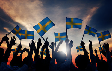 Group of People Waving Swedish Flags
