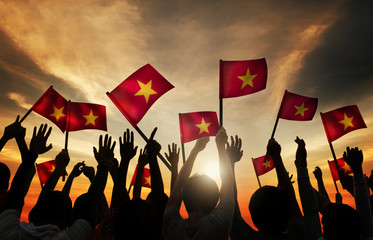 Group of People Waving Vietnamese Flags