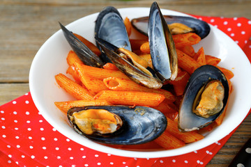 pasta with mussels in a bowl on napkin