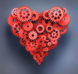Herz aus roten Zahnrädern auf Grau