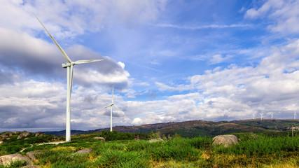 Wind turbine generator on top a hill