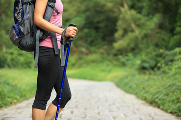 young fitness woman hiker on forest trail