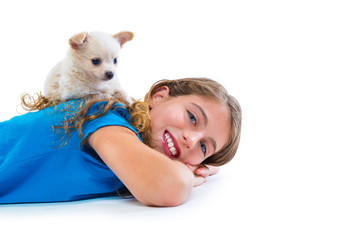 puppy chihuahua dog on kid girl lying happy smiling