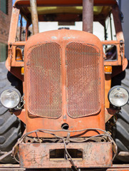 Front view of old red tractor and cab