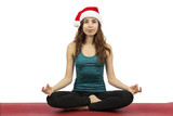 Young christmas woman in seated pose in yoga