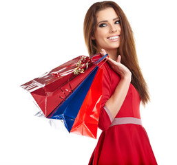 young happy smiling woman with shopping bags, isolated over whit