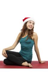 Christmas yoga woman doing spinal twist