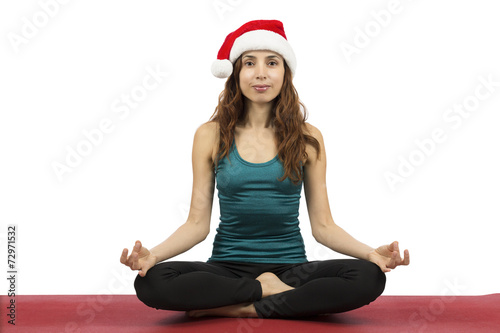 Young christmas woman in seated pose in yoga - 72971532