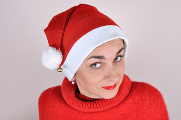 Portrait of a woman with Santa hat and a red turtleneck sweater