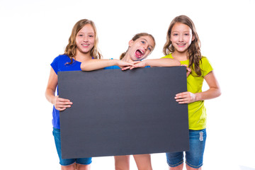 happy kid girls holding black board copyspace