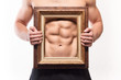 Muscular man with six-pack and frame on his torso - 72972783