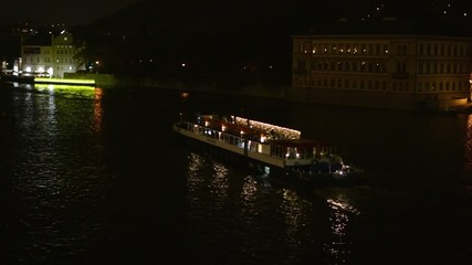 night city - night river with boat (ship)