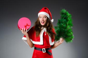 Snow santa girl in christmas concept